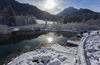 Views to Zelenci spring near Kranjska Gora on sunny morning of Sunday, 15th of January 2017, after snow storm passed Kranjska Gora, Slovenia, and delivered long awaited 30 to 40cm of fresh snow. <br> Zelenci Springs is a nature reserve near the town of Kranjska Gora, in the far northwestern corner of Slovenia. It is the source of the Sava Dolinka River.