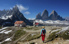 Hikers on their way on trails around Drei Zinnen - Tre Cime above Misurina, Italy, during early morning hike on Tuesday, 25th of June 2019.