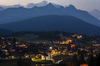 View to Seefeld village, church and village lights in late evening from nearby mountain.