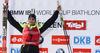Winner Martin Fourcade of France celebrates his medal won in the Men pursuit race of IBU Biathlon World Cup in Hochfilzen, Austria. Men pursuit race of IBU Biathlon World cup was held on Sunday, 14th of December 2014 in Hochfilzen, Austria.
