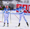 Sanna Markkanen of Finland (L) and Matti Hakala of Finland during mixed relay race of IBU Biathlon World Cup in Canmore, Alberta, Canada. Mixed relay race of IBU Biathlon World cup was held in Canmore, Alberta, Canada, on Sunday, 7th of February 2016.