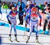 Mari Laukkanen (L) and Kaisa Makarainen of Finland (R) during exchange during mixed relay race of IBU Biathlon World Cup in Canmore, Alberta, Canada. Mixed relay race of IBU Biathlon World cup was held in Canmore, Alberta, Canada, on Sunday, 7th of February 2016.