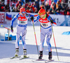 Kaisa Makarainen and Attu Toivanen of Finland during exchange during mixed relay race of IBU Biathlon World Cup in Canmore, Alberta, Canada. Mixed relay race of IBU Biathlon World cup was held in Canmore, Alberta, Canada, on Sunday, 7th of February 2016.
