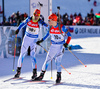 Anti Toivanen (L) and Tuomas Ironman of Finland (R) during last exchange during mixed relay race of IBU Biathlon World Cup in Canmore, Alberta, Canada. Mixed relay race of IBU Biathlon World cup was held in Canmore, Alberta, Canada, on Sunday, 7th of February 2016.