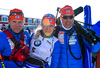 Second placed Kaisa Makarainen (M) with coaches Henri Rauhamaki (L) and Ville Kotikumpu (R) after women pursuit race of IBU Biathlon World Cup in Presque Isle, Maine, USA. Women pursuit race of IBU Biathlon World cup was held in Presque Isle, Maine, USA, on Friday, 12th of February 2016.
