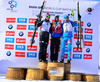 Winner Martin Fourcade of France (M), second placed Johannes Thingnes Boe of Norway (L) and third placed Anton Shipulin of Russia (R) celebrate their medals won in the during men pursuit race of IBU Biathlon World Cup in Presque Isle, Maine, USA. Men pursuit race of IBU Biathlon World cup was held in Presque Isle, Maine, USA, on Friday, 12th of February 2016.