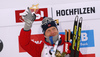 Winner Johannes Thingnes Boe of Norway celebrates his medal won in the men 10km sprint race of IBU Biathlon World Cup in Hochfilzen, Austria.  Men 10km sprint race of IBU Biathlon World cup was held in Hochfilzen, Austria, on Friday, 8th of December 2017.