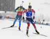 Johannes Thignes Boe of Norway and Martin Fourcade of France during the men 12.5km pursuit race of IBU Biathlon World Cup in Hochfilzen, Austria.  Men 12.5km pursuit race of IBU Biathlon World cup was held in Hochfilzen, Austria, on Saturday, 9th of December 2017.