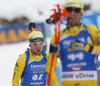 Jesper Nelin of Sweden (L) and Fredrik Lindstroem of Sweden in finish of the men 12.5km pursuit race of IBU Biathlon World Cup in Hochfilzen, Austria.  Men 12.5km pursuit race of IBU Biathlon World cup was held in Hochfilzen, Austria, on Saturday, 9th of December 2017.