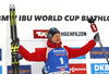 Winner Johannes Thingnes Boe of Norway celebrate his medal won in the men 12.5km pursuit race of IBU Biathlon World Cup in Hochfilzen, Austria.  Men 12.5km pursuit race of IBU Biathlon World cup was held in Hochfilzen, Austria, on Saturday, 9th of December 2017.