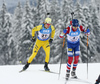 Peppe Femling of Sweden (L) and Ole Einar Bjoerndalen of Norway (R) during the men relay race of IBU Biathlon World Cup in Hochfilzen, Austria.  Men relay race of IBU Biathlon World cup was held in Hochfilzen, Austria, on Sunday, 10th of December 2017.