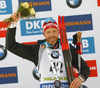 Third placed Simon Eder of Austria celebrates on the podium after the men individual race of IBU Biathlon World Cup in Pokljuka, Slovenia. Men 20km individual race of IBU Biathlon World cup 2018-2019 was held in Pokljuka, Slovenia, on Thursday, 6th of December 2018.