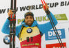 Winner Martin Fourcade of France  celebrates on the podium after the men individual race of IBU Biathlon World Cup in Pokljuka, Slovenia. Men 20km individual race of IBU Biathlon World cup 2018-2019 was held in Pokljuka, Slovenia, on Thursday, 6th of December 2018.