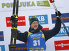 Winner Johannes Thingnes Boe of Norway  celebrates on the podium after the men sprint race of IBU Biathlon World Cup in Pokljuka, Slovenia. Men sprint race of IBU Biathlon World cup 2018-2019 was held in Pokljuka, Slovenia, on Friday, 7th of December 2018.