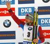 Third placed Alexander Loginov of Russia celebrates his medal won in  the men pursuit race of IBU Biathlon World Cup in Pokljuka, Slovenia. Men pursuit race of IBU Biathlon World cup 2018-2019 was held in Pokljuka, Slovenia, on Sunday, 9th of December 2018.