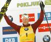 Winner Johannes Thingnes Boe of Norway celebrates on the podium after the men pursuit race of IBU Biathlon World Cup in Pokljuka, Slovenia. Men pursuit race of IBU Biathlon World cup 2018-2019 was held in Pokljuka, Slovenia, on Sunday, 9th of December 2018.