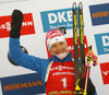 Winner Kaisa Makarainen of Finland celebrates on the podium after  the women pursuit race of IBU Biathlon World Cup in Pokljuka, Slovenia. Women pursuit race of IBU Biathlon World cup 2018-2019 was held in Pokljuka, Slovenia, on Sunday, 9th of December 2018.