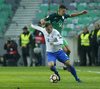 Jan Durica (no.4) of Slovakia and Roman Bezjak (no.14) of Slovenia during football match of FIFA World cup qualifiers between Slovenia and Slovakia. FIFA World cup qualifiers between Slovenia and Slovakia was played on Saturday, 8th of October 2016 in Stozice arena in Ljubljana, Slovenia.