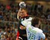 Paul Drux of Germany and David Miklavcic of Slovenia during EHF European championships qualifications match between Slovenia and Germany. EHF European championships qualifications match between Slovenia and Germany was played on Wednesday, 3rd of May 2017 in Stozice arena in Ljubljana, Slovenia.