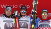 Winner Beat Feuz of Switzerland (R) and second placed Vincent Kriechmayr of Austria (L) and Dominik Paris of Italy (R) celebrate on the podium after men downhill race of the Audi FIS Alpine skiing World cup in Garmisch-Partenkirchen, Germany. Men downhill race of the Audi FIS Alpine skiing World cup was held on Kandahar track in Garmisch-Partenkirchen, Germany, on Saturday, 27th of January 2018.
