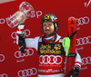 Winner Marcel Hirscher of Austria celebrates on the podium after the men slalom race of the Audi FIS Alpine skiing World cup in Kranjska Gora, Slovenia. Men slalom race of the Audi FIS Alpine skiing World cup was held on Podkoren track in Kranjska Gora, Slovenia, on Sunday, 4th of March 2018.