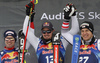 Winner Dominik Paris of Italy (M), second placed Beat Feuz of Switzerland (L) and third placed Otmar Striedinger of Austria (R) celebrate their medals won in the men downhill race of the Audi FIS Alpine skiing World cup Kitzbuehel, Austria. Men downhill Hahnenkamm race of the Audi FIS Alpine skiing World cup season 2018-2019 was held Kitzbuehel, Austria, on Friday, 25th of January 2019.