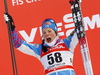 Winner Krista Parmakoski of Finland celebrates on podium after  women 10km classic race of Viessmann FIS Cross country skiing World cup in Planica, Slovenia. Women 10km classic race of Viessmann FIS Cross country skiing World cup was held on Sunday, 21st of January 2018 in Planica, Slovenia.