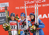 Third placed Charlotte Kalla of Sweden (L), winner Krista Parmakoski of Finland (M) and Heidi Weng of Norway (R) celebrate their success on podium after  women 10km classic race of Viessmann FIS Cross country skiing World cup in Planica, Slovenia. Women 10km classic race of Viessmann FIS Cross country skiing World cup was held on Sunday, 21st of January 2018 in Planica, Slovenia.