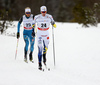 Simon Lageson of Sweden (24) and Alexis Jeannerod of France (25) skiing in men 15km classic race of Viessmann FIS Cross country skiing World cup in Planica, Slovenia. Men 15km classic race of Viessmann FIS Cross country skiing World cup was held on Sunday, 21st of January 2018 in Planica, Slovenia.