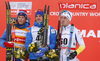 Second placed Johannes Hoesflot Klaebo of Norway (L), winner Alexey Poltoranin of Kazakhstan (M) and third placed Calle Halfvarsson of Sweden (R) celebrate their success on podium after 15km classic race of Viessmann FIS Cross country skiing World cup in Planica, Slovenia. Men 15km classic race of Viessmann FIS Cross country skiing World cup was held on Sunday, 21st of January 2018 in Planica, Slovenia.