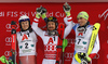 Winner Marcel Hirscher of Austria(M), second placed Henrik Kristoffersen of Norway (L) and third placed Daniel Yule of Switzerland (R)  celebrate on podium after the men The Nightrace, night slalom race of the Audi FIS Alpine skiing World cup in Schladming, Austria. Men slalom race of the Audi FIS Alpine skiing World cup was held in Schladming, Austria, on Tuesday, 23rd of January 2018.